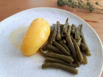 Bohnen und Kartoffeln in Buttersoße